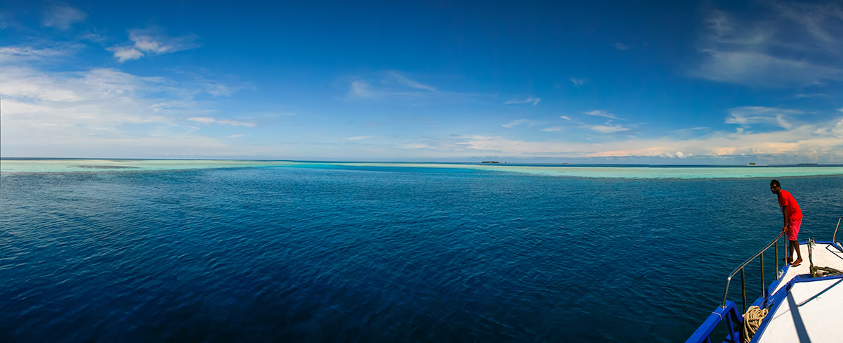 About Going the Whole Hogg: Blue sea and sky lagoon panorama
