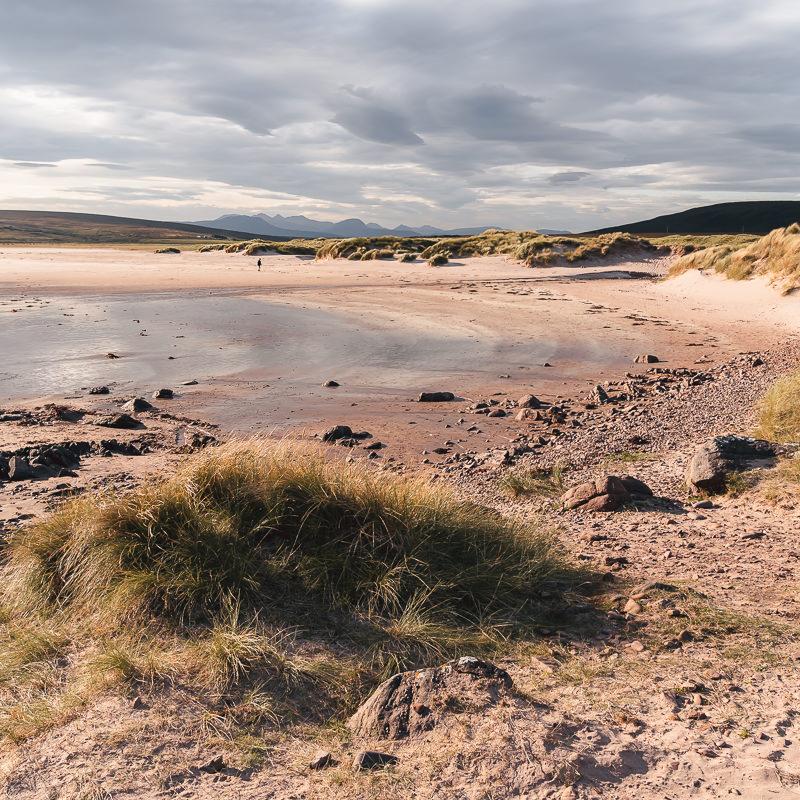 Morning sun illuminates Achnahaird Beach, a possible side trip from Scotland's North Coast 500 route
