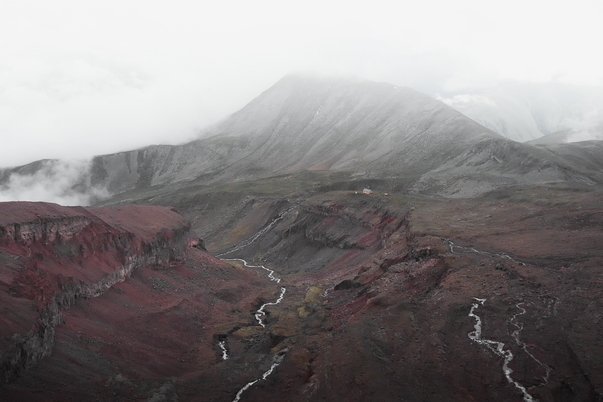 A misty aerial view from Gergeti Glacier, looking northest back down the valley in the direction of Kazbegi