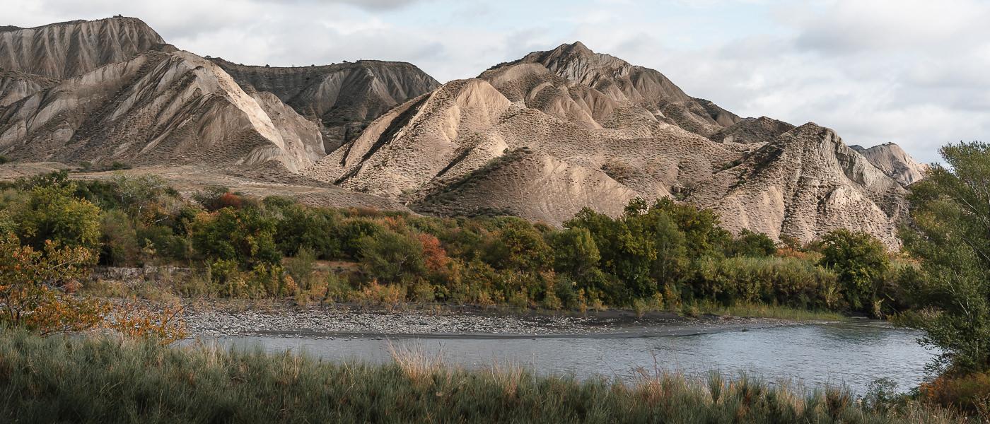 The Alazani River runs past dusty rock pinnacles at Mijniskure in Vashlovani National Park