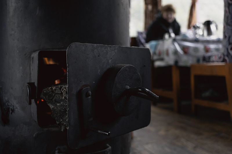 Flames in a cast iron fire inside a dining room on the Annapurna Circuit