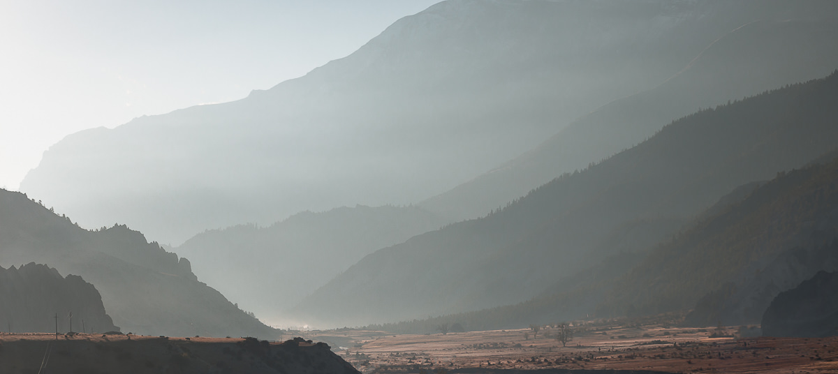 View down the valley from the edge of Manang as the sun rises