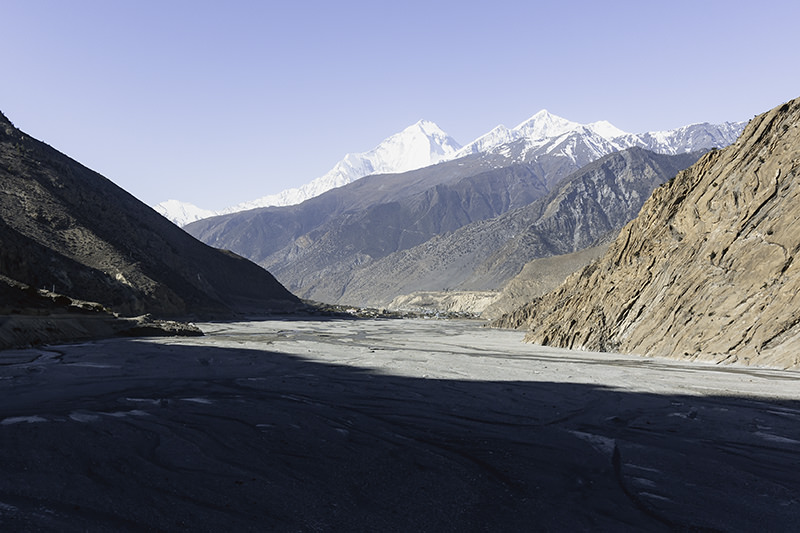The wide Kali Gandaki river, with snowy mountains rising behind