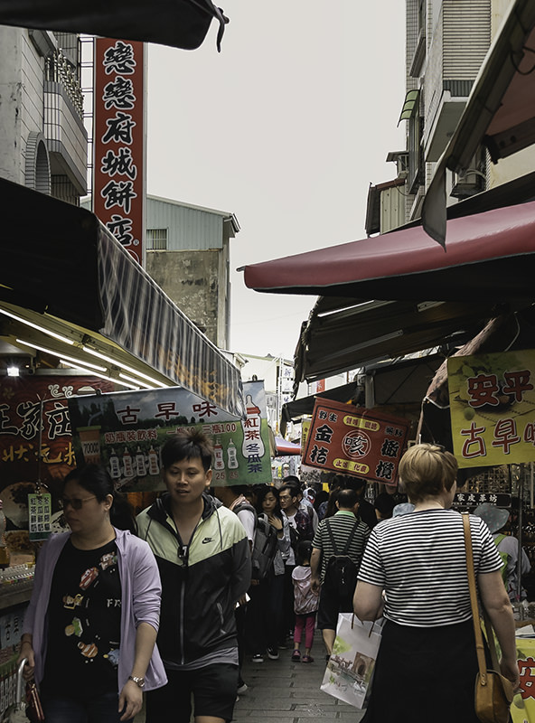 Crowds thronging the busy Anping Old Street in Tainan, Taiwan