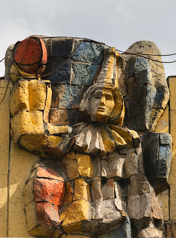 A huge, colourful bas relief clown on the side of the Soviet era state circus in Bishkek
