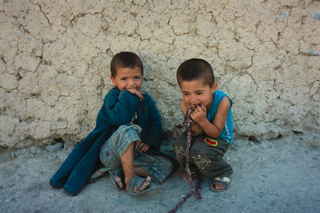 Two young boys pretending to be shy in the village of Guitan in the Fann Mountains in Tajikistan.
