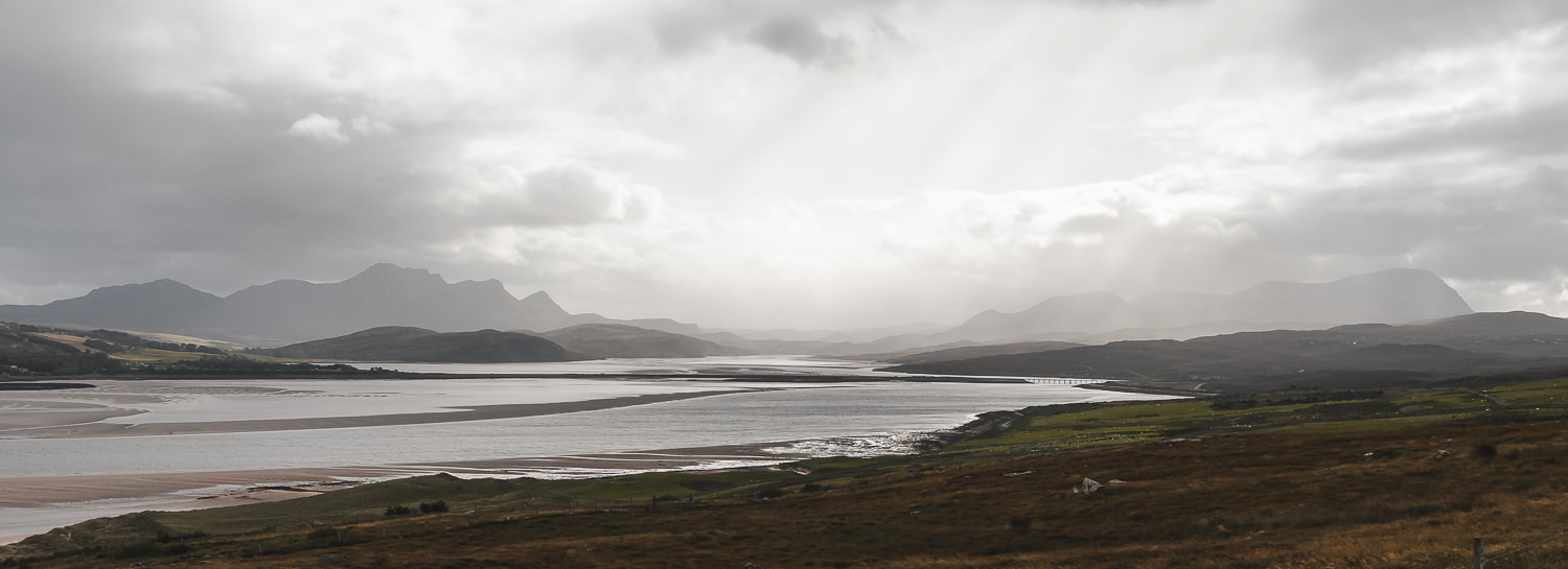 The sun breaks through the clouds to light up the Kyle of Tongue, with Ben Loyal to the left and Ben Hope to the right