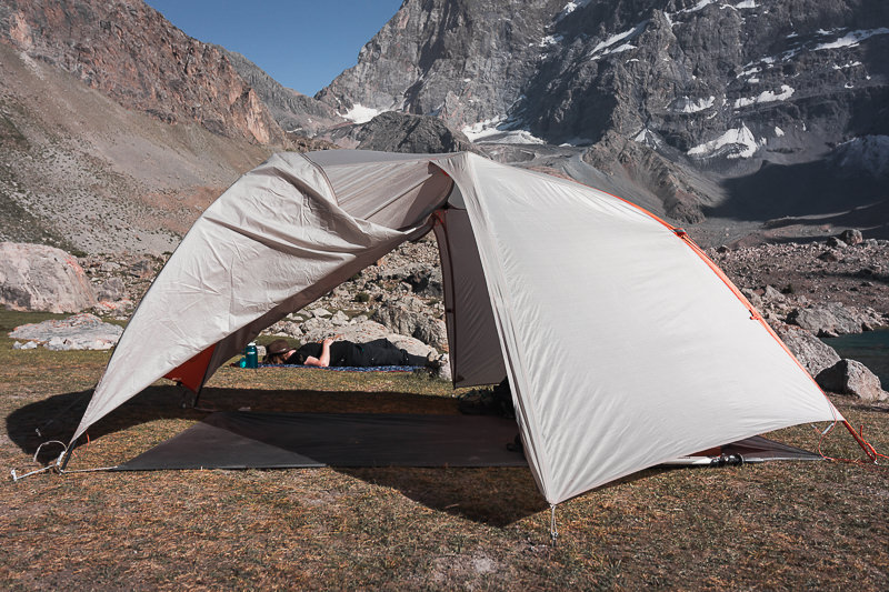 An essential part of our backpacking camping gear, here the Big Agnes Copper Spur fly and footprint is pitched at Dushakha Lakes in Tajikistan's Fann Mountains