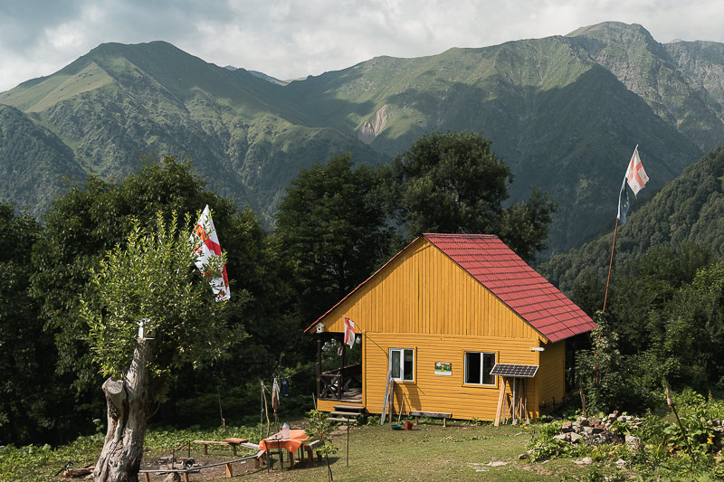 Brightly coloured Meteo Shelter in a forest clearing with mountain views is the place hikers stay at the end of Day 1 on the Black Rock Lake trek in Lagodekhi National Park