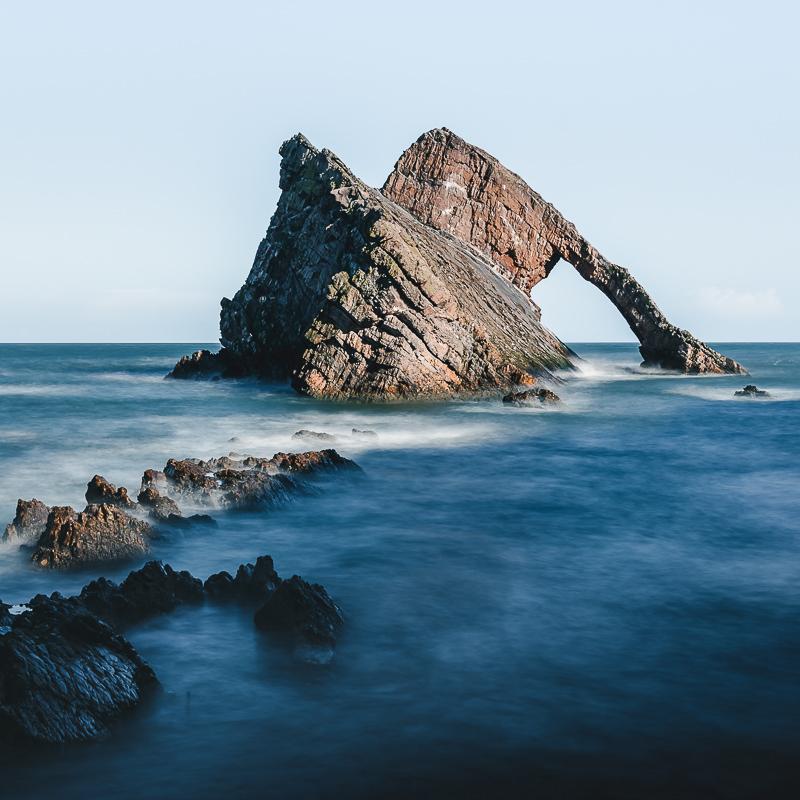 The uniquely shaped Bow Fiddle Rock on Scotland's Moray Coast