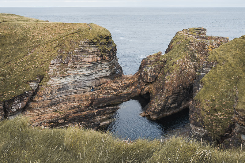 The sheltered geo next to the Brough of Deerness with the path climbing up onto the brough seen on the left
