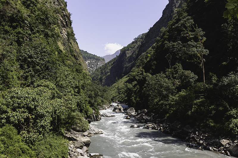 The Budhi Gandaki cuts through the steep-sided, densely forested valley