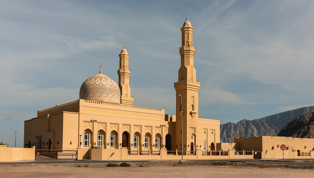 The mosque at Bukha in Musandam, glowing golden in the morning sun