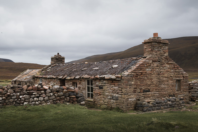 The traditional stone cottage that is now free to use as Burnmouth Bothy at Rackwick Bay on Hoy