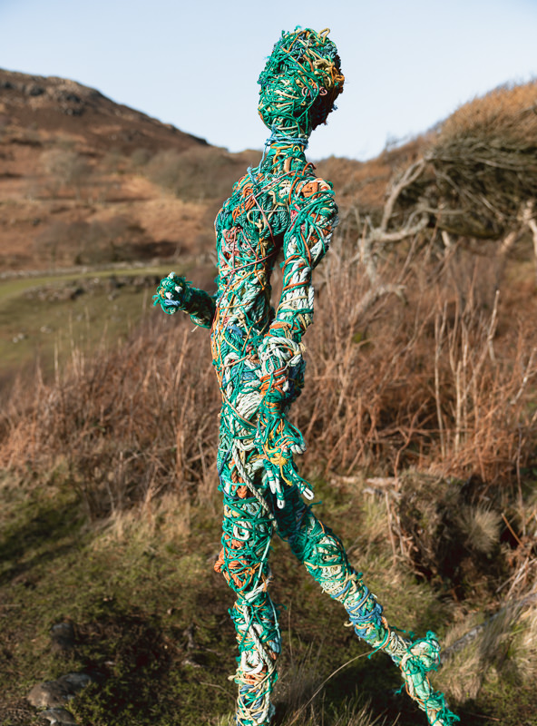 A statue of a woman made from old fishing ropes on the hillside overlooking Calgary Bay on the Isle of Mull in Scotland.