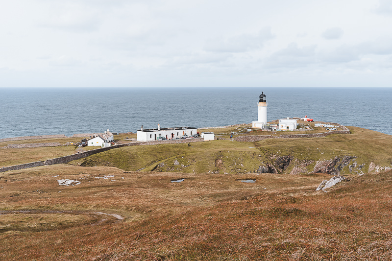 Cape Wrath Lighthouse sitting atop rocky cliffs at the most northwesterly point of mainland Scotland