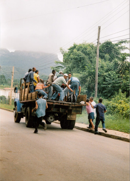 Cuba on Film - Men running to jump onto the back of a moving truck, Vinales, Cuba