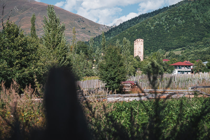 A centuries-old Svan tower rises above red-roofed houses in Etseri, on the Chuberi to Mestia section of the Transcaucasian Trail in Svaneti, Georgia