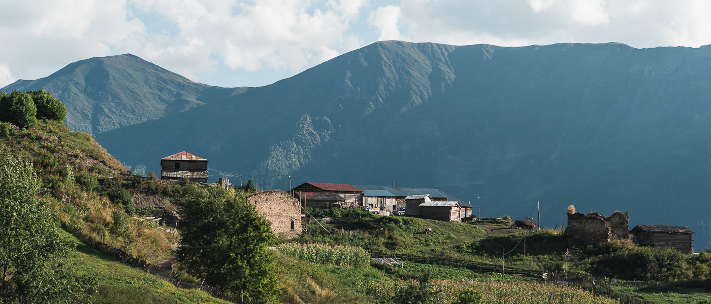 The village of Kichkhuldashi glowing in the afternoon sun, on the Chuberi to Mestia section of the Transcaucasian Trail in Svaneti, Georgia