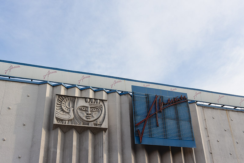 The north facade of the Arman Cinema, a distinctive example of Soviet-era art and architecture in Almaty.