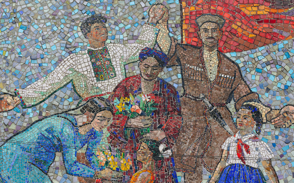 Close up of people from the Soviet mosaic 'Welcoming Guests' in Bishkek