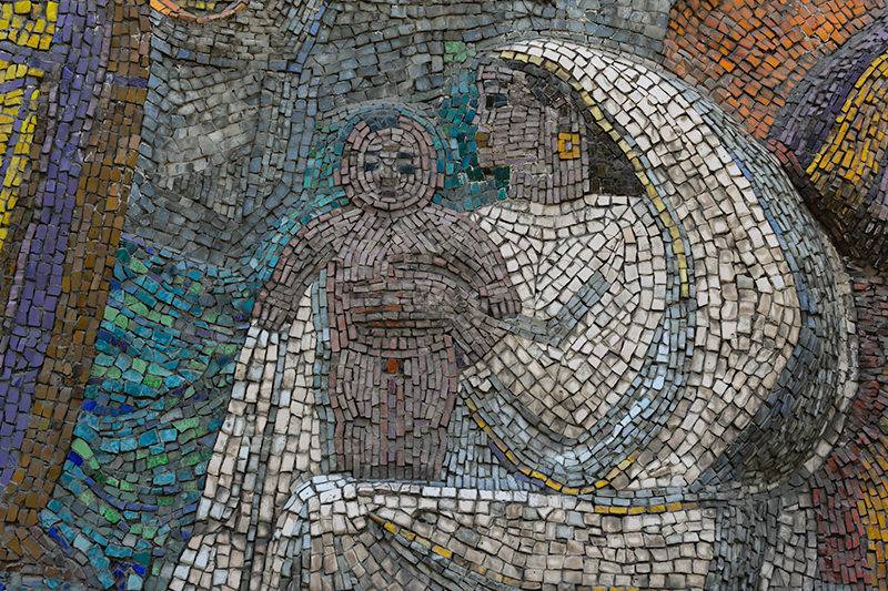 Close up of the madonna-like figure from the Soviet mosaic 'Lenin Is With Us' in Bishkek