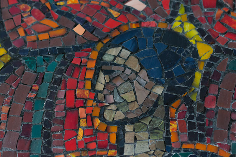 Close up shot of a woman's head in the Soviet mosaic 'Song' in the Shubin Music School in Bishkek