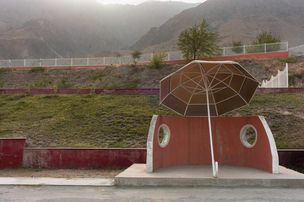 A concrete half circle soviet bus stop near Kalai Khum in Tajikistan