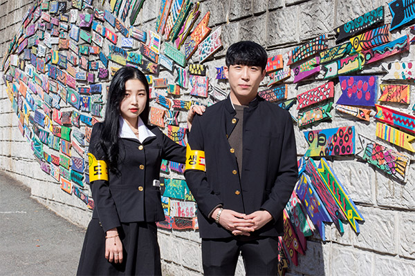 Busan City Guide: A young couple dressed up in school uniforms from the past in Gamcheon Culture Village