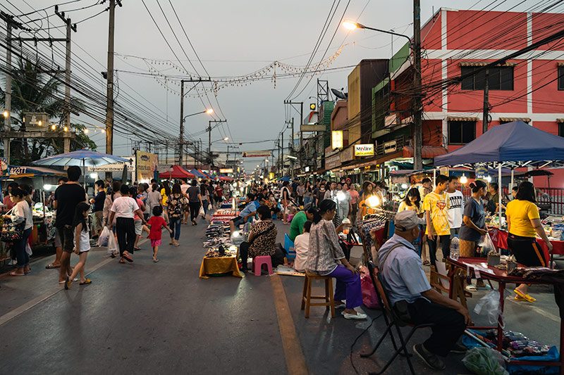 The crowd builds as dusk approaches at the San Kamphaeng Saturday Market in Chiang Mai, Thailand