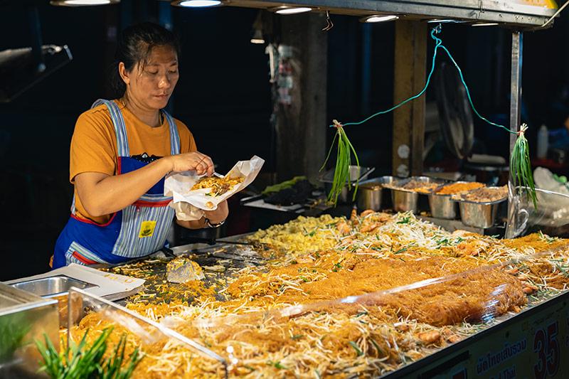 Pad Thai being served up at the San Kamphaeng Saturday Market in Chiang Mai, Thailand