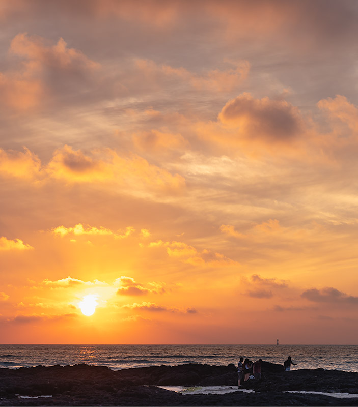 The sun setting at Geumneung Beach on Jeju Island, one of the best beaches on Jeju.