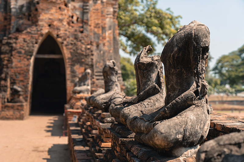 A row of headless Buddha statues at Wat Chaiwatthanaram in Ayutthaya, Thailand