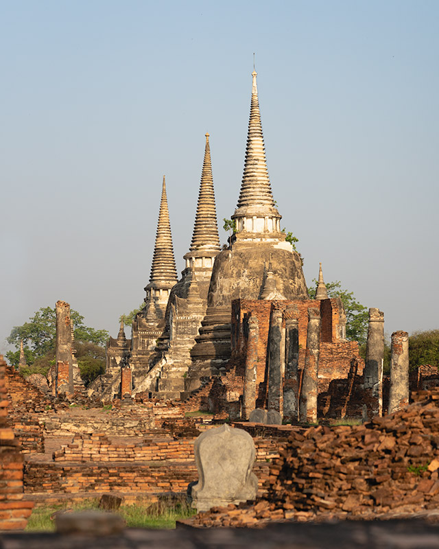 The three central cone like towers of Wat Phra Si Sanphet at sunrise in Ayutthaya, Thailand