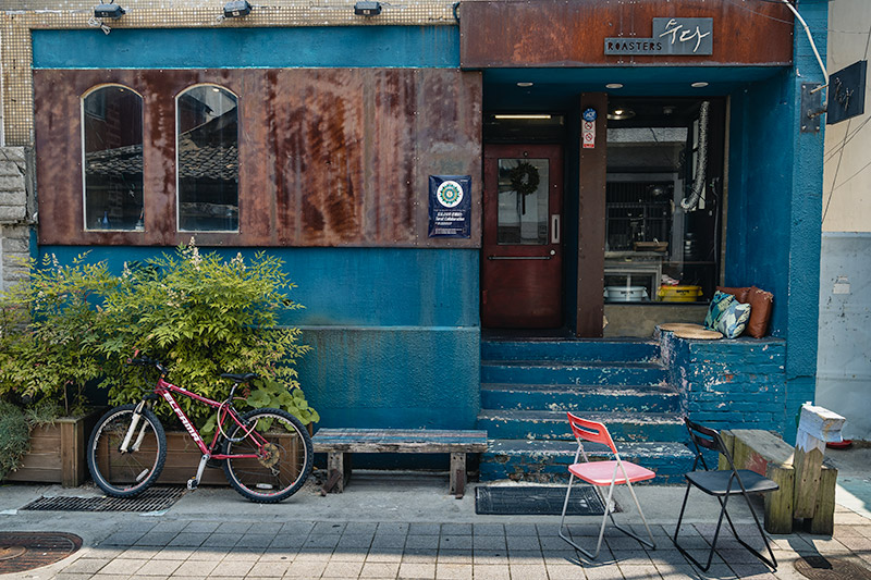 The blue and brown stylishly faded facade of Sooda Coffee Roasters in Tongyeong