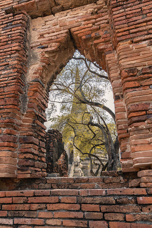 Looking through an open window to the central towers of Wat Phra Si Sanphet in Ayutthaya, Thailand