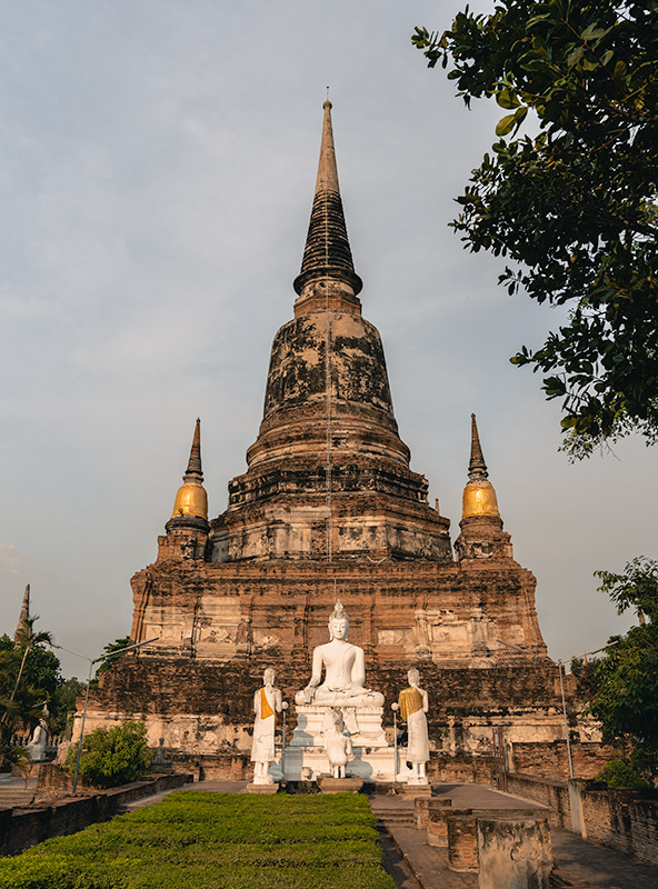 The central prang of Wat Yai Chai Mongkhon glowing in the late afternoon sun in Ayutthaya, Thailand