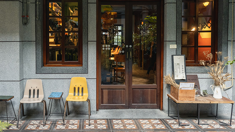 The stylishly tiled courtyard looking into the softly lit Peacock Bistro in Dadaocheng, Taipei's oldest neighbourhood