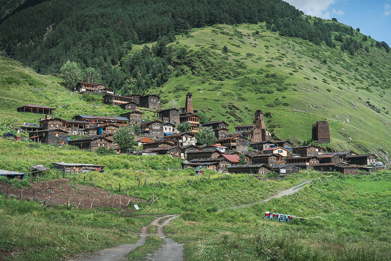A view from the west of the stone and wood houses of the Tushetian village of Dartlo, a stop off on the Shatili Omalo trek in Georgia