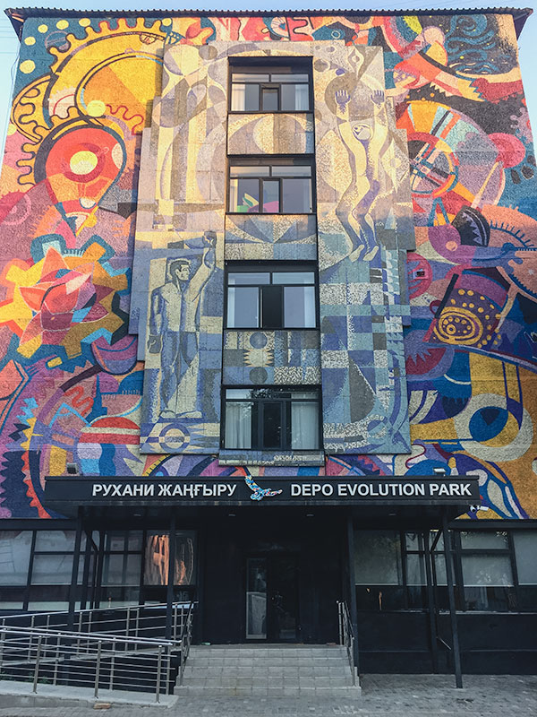 The original mosaic and new mural at the Depo Evolution Park. The original mosaic, once brightening up a drab gray facade, now shares the wall with a striking multicoloured mural.