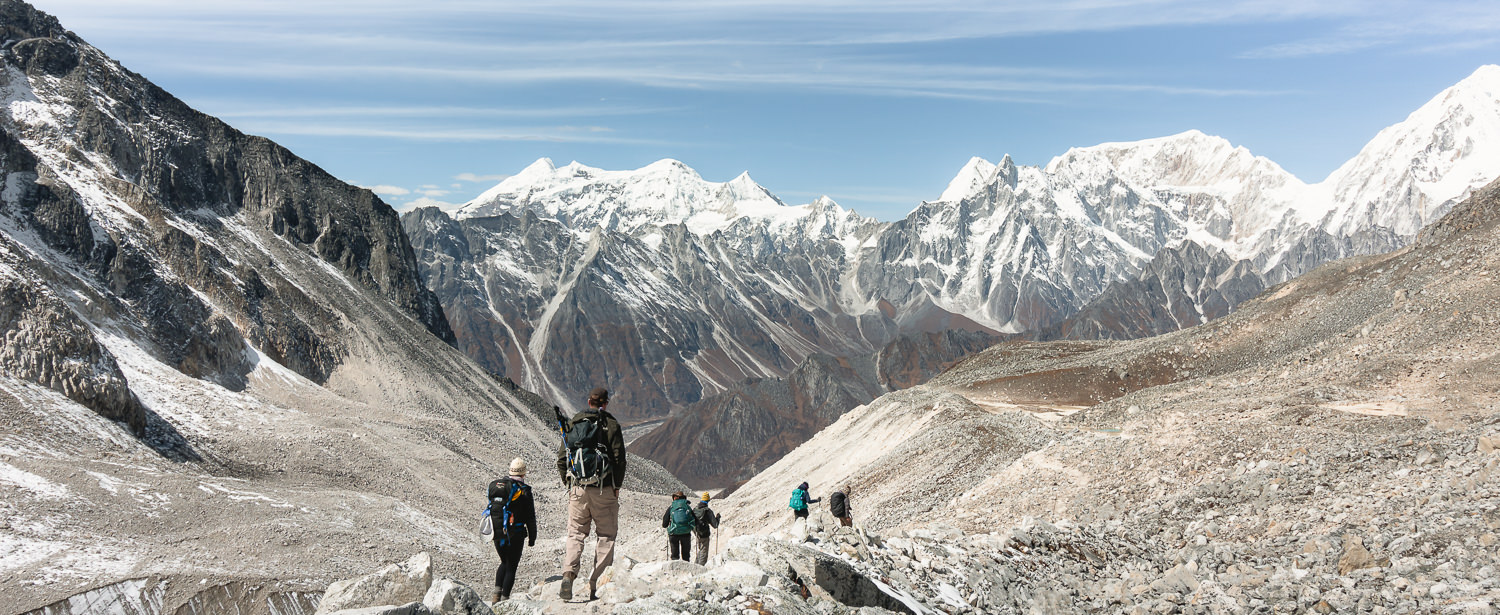 Trekkers look out while descending from the Larke Pass on the Manaslu Circuit Trek
