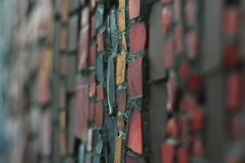 Detail of colourful smalt tiles in the Soviet era mosaic 'Song' in Bishkek