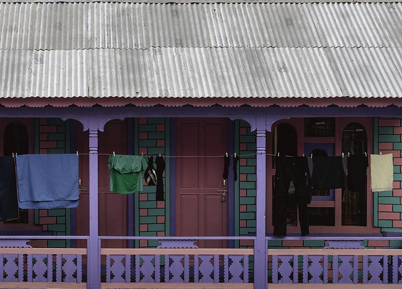 Laundry hanging outside the rooms of the garishly coloured Kamala Hotel in Dhukur Pokhari on the Annapurna Circuit Trek