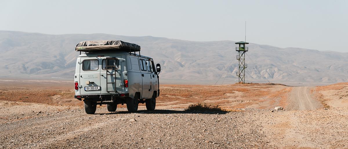 A UAZ Buhanka camper van driving the track between Takhti-Tepha and Kilakupra mud volcanos, close to the Azerbaijan border in southeastern Georgia