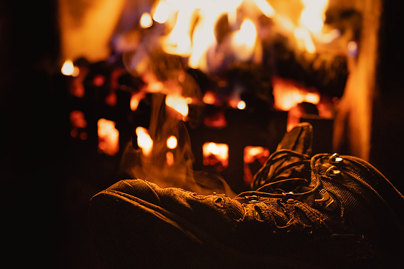 The fire serves one of its many purposes in Peanmeanach Bothy, drying wet boots for the next day