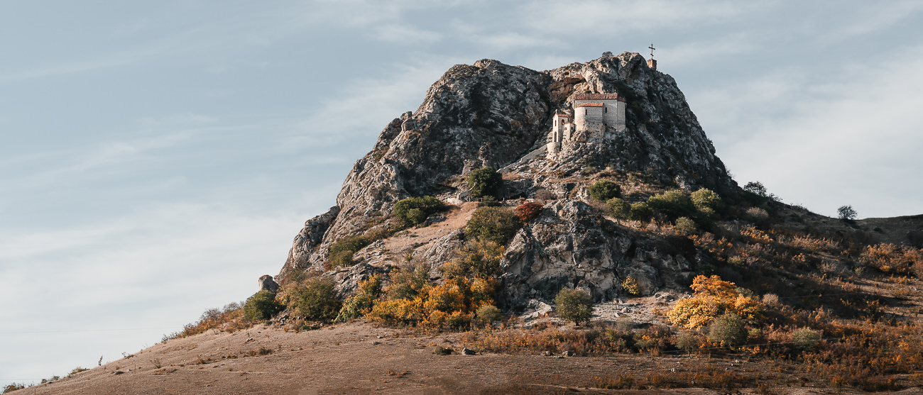 Elia Monastery perched on a rocky outcrop in the middle of the open plains in the Vashlovani Protected Areas