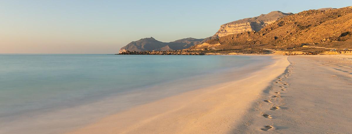 Fazayah Beach near Salalah at sunrise with soft golden tones