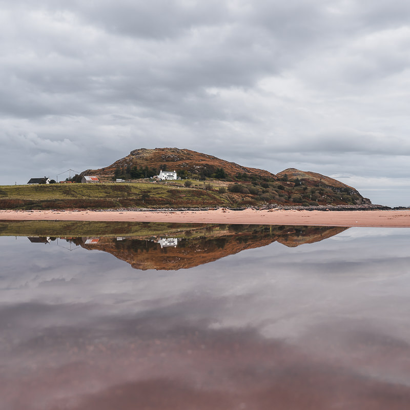 Picture perfect whitewashed houses and mirror like reflections at Firemore Beach, an easy North Coast 500 side trip