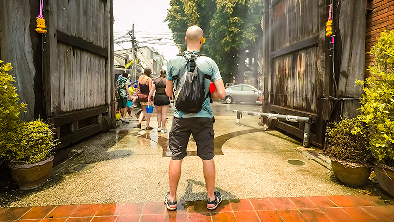 Standing at Thapae Gate in Chiang Mai during the street water fight at the Songkran Festival, valuables kept dry by the stylish Scrubba Stealth Pack