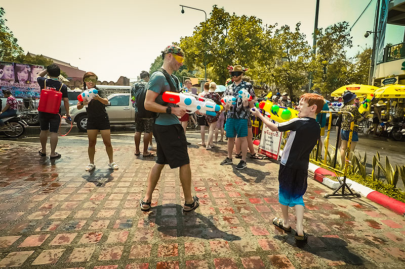 People square off with water guns at the Songkran Festival in Chiang Mai, Thailand